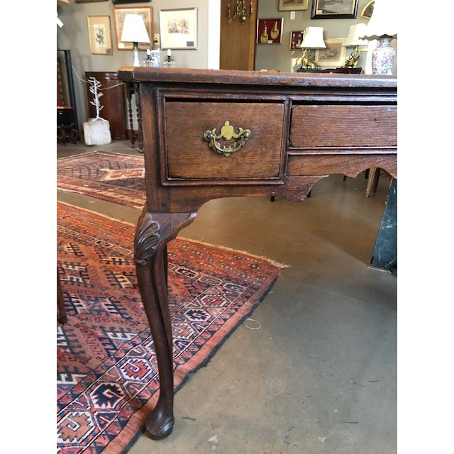 Circa 1900 Louis XV style French country oak writing desk with cabriole legs and brass hardware. Solid, sturdy condition...