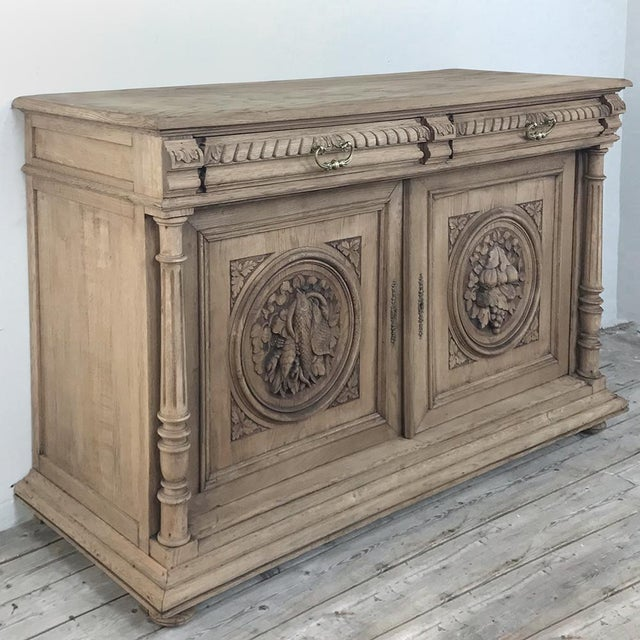 19th Century French Renaissance Stripped Oak Buffet is a marvel of the wood sculptor's craft, with bold full relief...