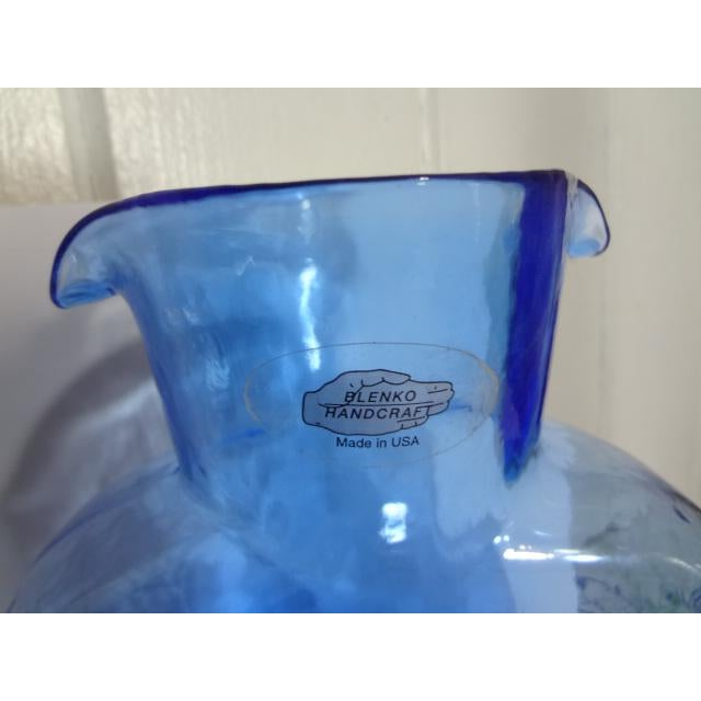 I love these in every color ! Blenko double spout water bottle, transparent blue, with label attached. These hand made...