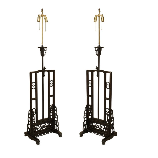 2 Asian Chinese (20th Cent) hardwood floor lamps with a open center panel supported by filigree fretwork side panels...