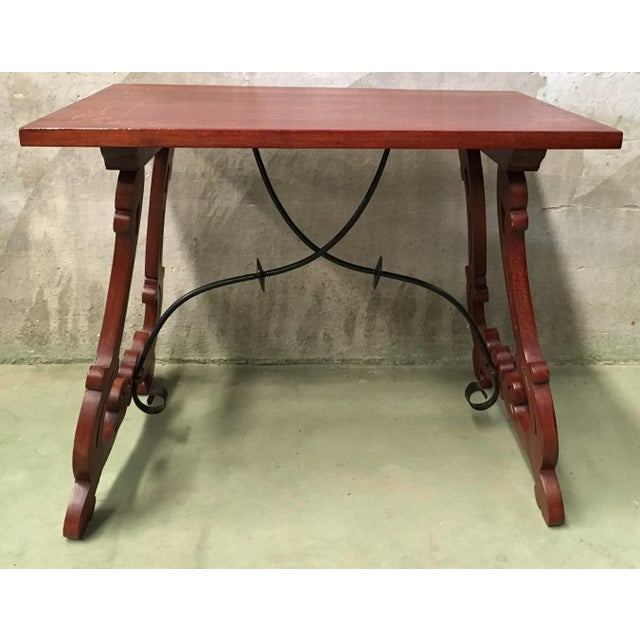 About 19th century Spanish trestle table in mahogany. This piece has a great scale, lovely carved lyre legs and beautiful...