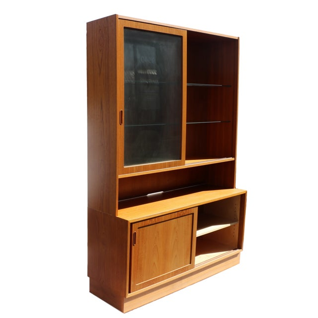 This two-piece hutch resting on a credenza base, Danish Modern Teak credenza, Media china Cabinet is beautifully...