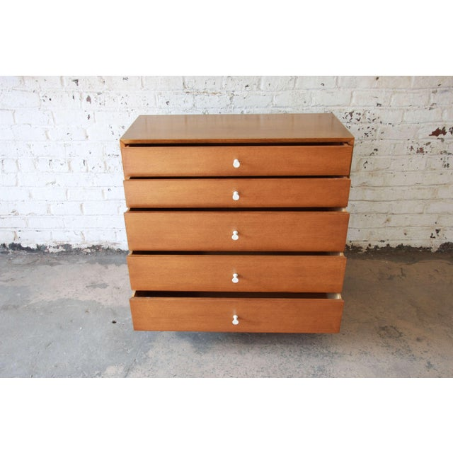 Offering a rare and stunning thin edge dresser by George Nelson for Herman Miller. The dresser features five graduated...