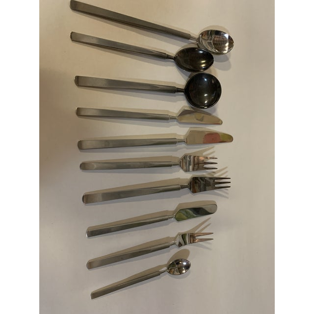 Obelisk Denmark stainless set of mid-century flatware. 82 pieces. And original pamphlet. Serving for 8 with additional...