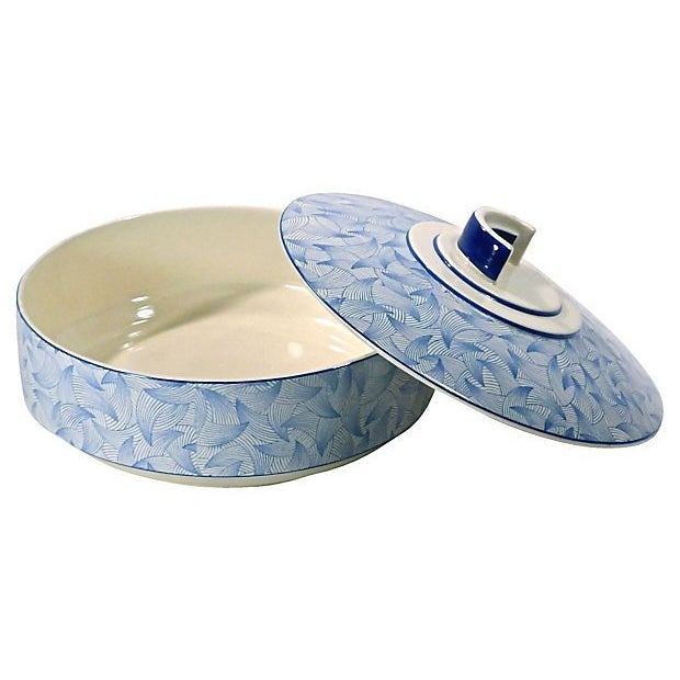 From between 1910-1950, this English Art Deco-style Royal Doulton serving dish has a semi-circular handle on the lid and...