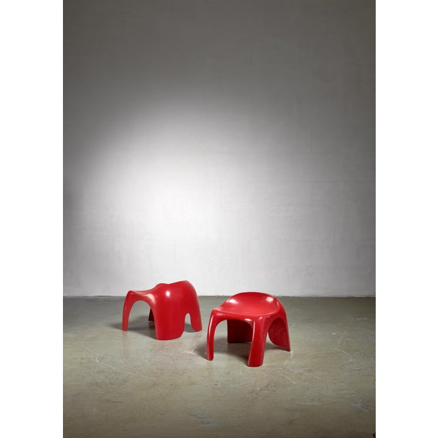 A pair of red polyester stools, by American designer Stacy Dukes in the 1960s. This model was also produced by Artemide in...