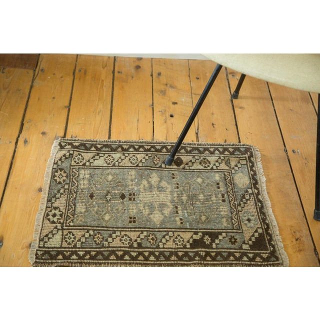 Bold geometric square rug mat with very subtle triple center medallions. Barber pole main border motif comprised of...
