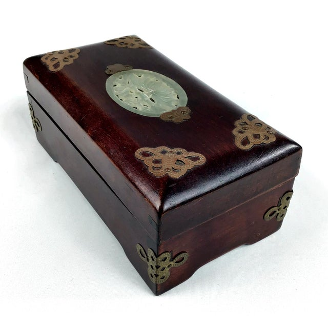 Hand carved rosewood is shaped into a beautiful box to hold your cigarettes and matches or lighter. It even has a place to...