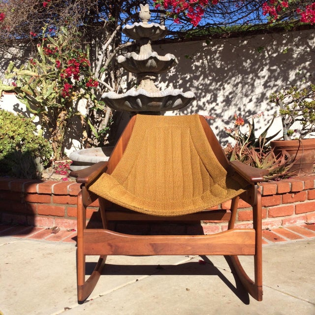 This is a stunning Mid-Century bentwood Jerry Johnson walnut rocking chair with original chartreuse upholstery, circa...