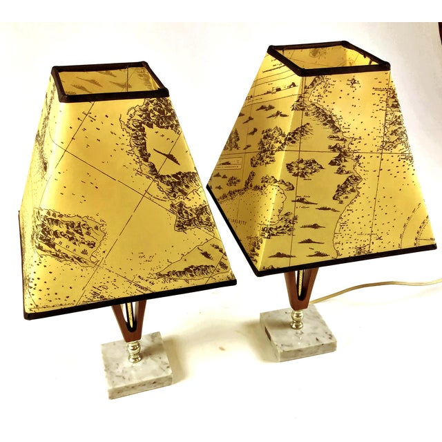 A delightful little pair of lamps made in Italy of grey marble, teakwood and heavy printed waxy paper printed shades. 12...