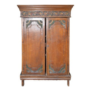 Vintage Indonesian Armoire with Polychrome Accents and Medallion Carved Frieze For Sale
