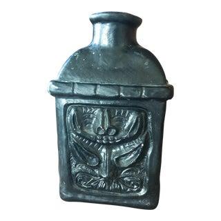 Tribal Black Ceramic Pottery Vase With Primitive Totem Face Carving For Sale