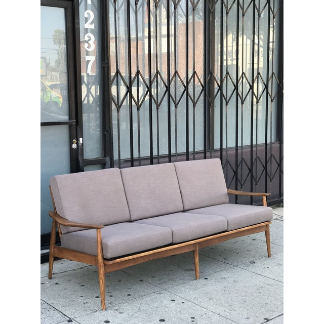Oak and walnut three seater sofa in a modern Gray cool tone fresh fabric. This piece is open to different fabric options,...