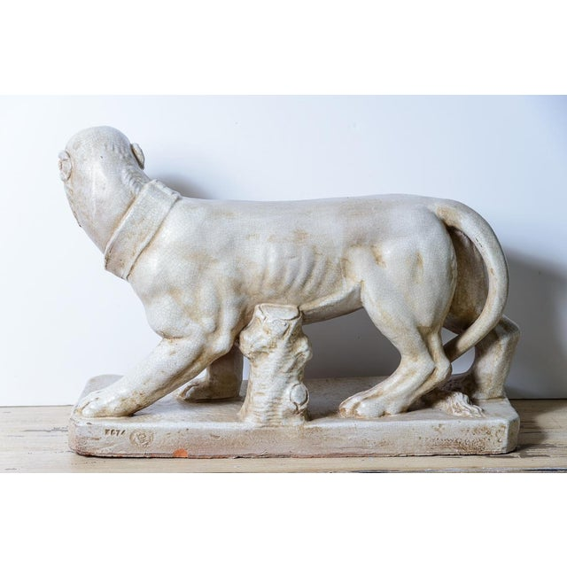 This Italian Neapolitan Mastiff Dog Sculpture look quite ferocious. This mastiff dog stands on a large plinth and is made...