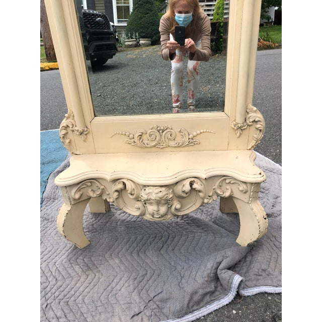 Fit for a Princess tall ornately carved painted cream pier mirror having pretty cherub face, cabriole feet and scalloped...