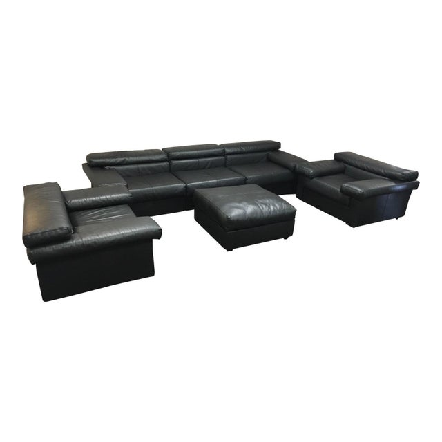"""Italian leather model """"Erasmo"""" living room set consists of one three seat sofa, and one oversized ottoman designed by the..."""