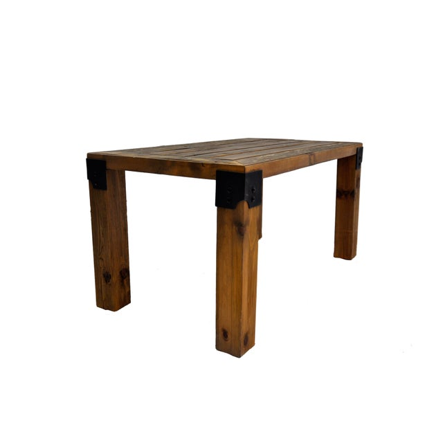 DARVO's first design! This simple rustic coffee table was handmade using reclaimed wood and metal corner accents. It is...