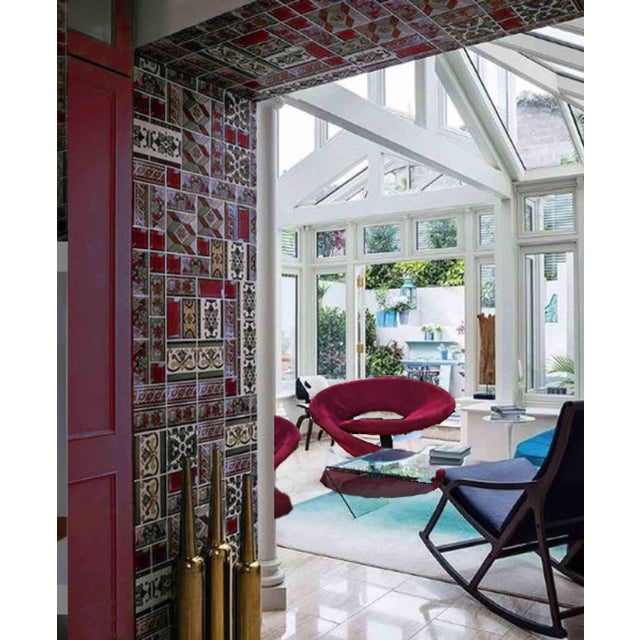 An outstanding set of red spiral chairs, furniture as art! In terms of color, think lipstick and red wine. Created by...