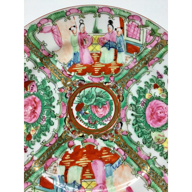 This is a vintage decorative plate hand-painted in Macau. This pretty vintage plate has the colors of the season. Brighten...