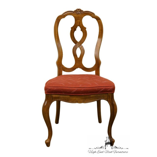 This chair would fit great in any dining room with brown and red colors. This seat would look great in a country style...