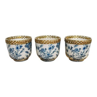 Chinese Brass Mounted Blue and White Porcelain Urns - Set of 3