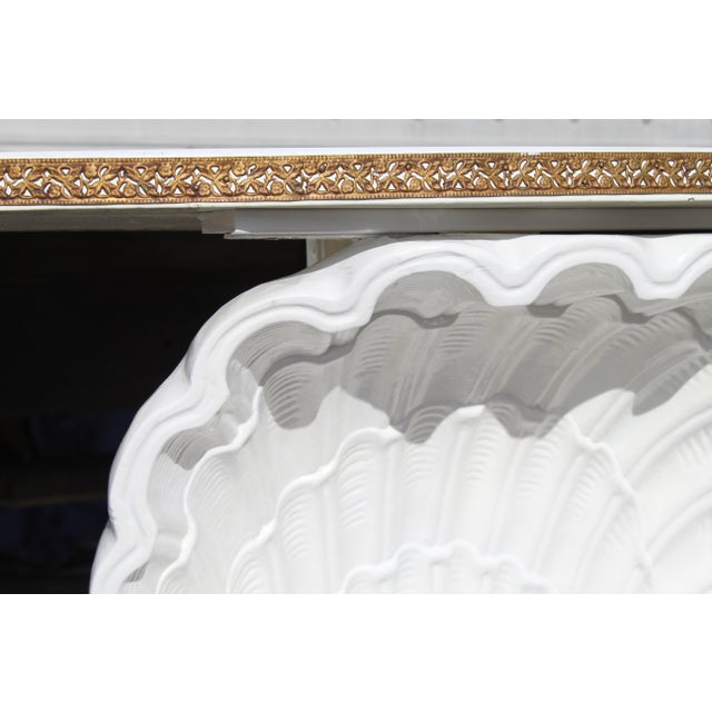 Hollywood regency white scallop shell demilune table. From the 1940s.