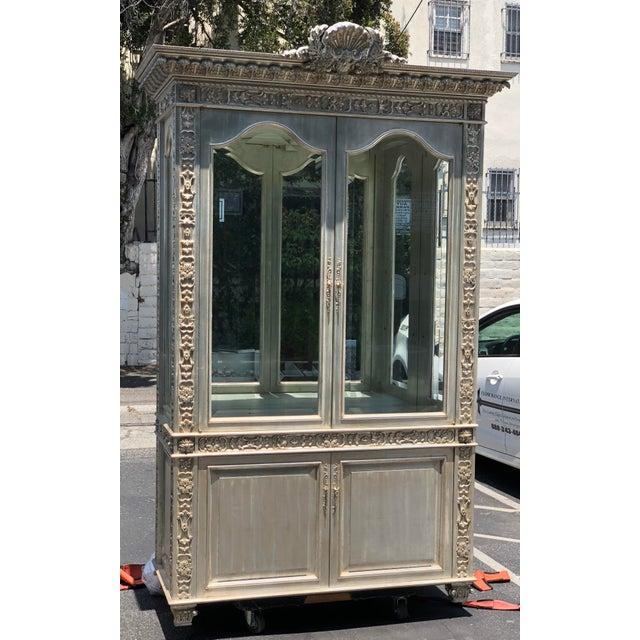 Huge Carved Designer Silver-leaf Showcase Cabinet This lovely Cabinet is a genuine designer original by Phyllis Morris. It...