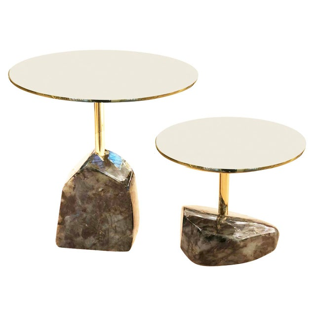 Pair of one of a kind side tables by Studio Superego each featuring a labradorite base and polished brass tops. Sold as a...