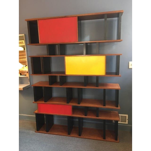 Perriand and Prouve style shelving system custom built for an East Village Bar in, circa 1999. Sliding doors move back and...