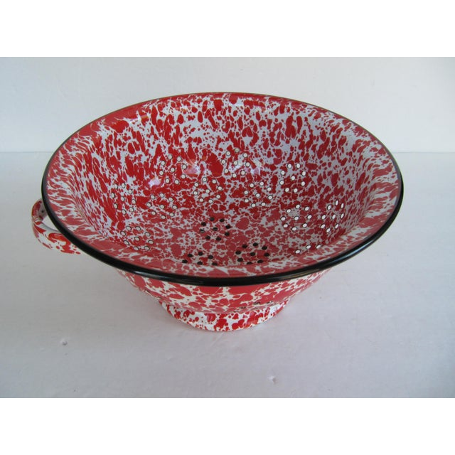 Vintage red and white spatterware strainer. A great piece to add a little pop of color and country to your kitchen.
