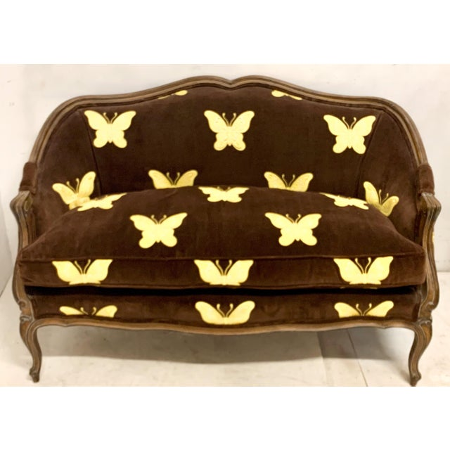 This is a French style settee in original brown velvet fabric embroidered with butterflies. The cushion is a thick down....