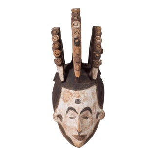 Wall-Mounted Carved Wood Sculpture of Igbo Mask Nigeria, Late 19th Century For Sale