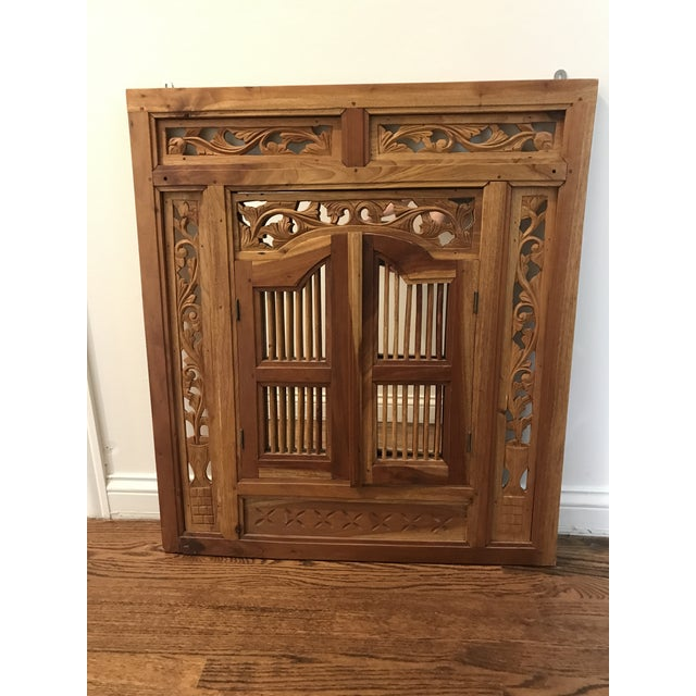 Pierced, carved, solid wood shutter window mirror. This piece will make a statement in your home! The mirror has been...