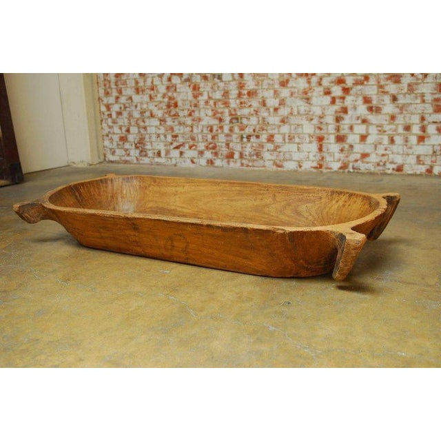 Large French carved wood dough bowl or wood trough with four handles. Features a beautiful antique wood patina with rich...