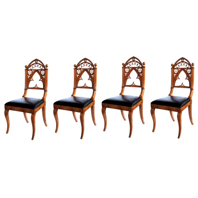 A handsome and well-carved set of 4 continental gothic revival klismos-form walnut side chairs; possibly Austrian or German For Sale