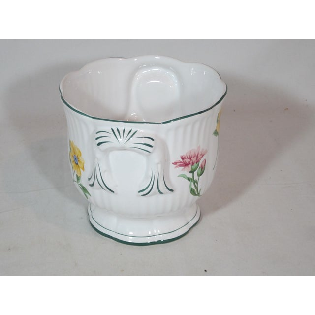 This is a elegant cachepot by Tiffany & Co. It is hand decorated with multi colored flowers and green accents. The...