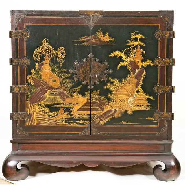 Good sized vintage Chinese cabinet made around 1950 having nice decoration and well crafted hardware. Interior with a...