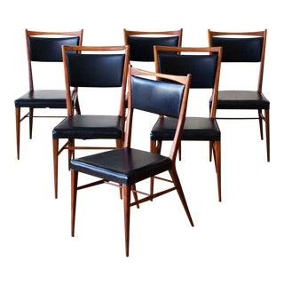 Paul McCobb Set of Six Walnut Dining Chairs. 1950s.