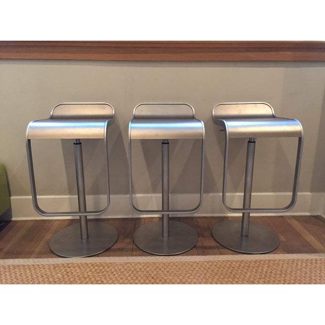 Set of three LEM Piston Stools by Shin and Tomoko Azumi. Stainless steel seats and bases. Made In Italy. Stool height...