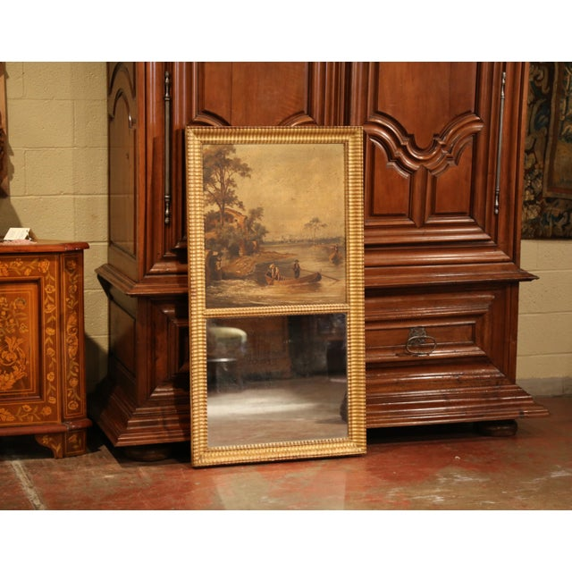 Elegant antique trumeau from France crafted circa 1850, the wall hanging mirror features a hand-painted pastoral scene on...