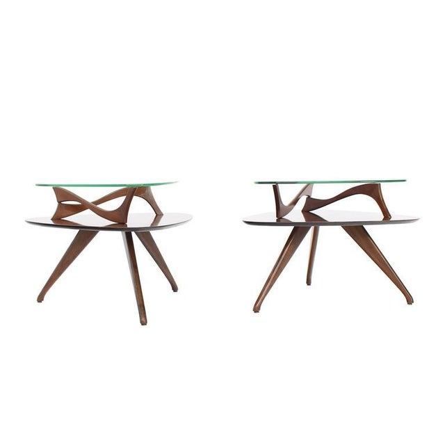 Vladimir Kagan style pair of very nice glass top walnut side or end tables on beautiful sculptured legs.