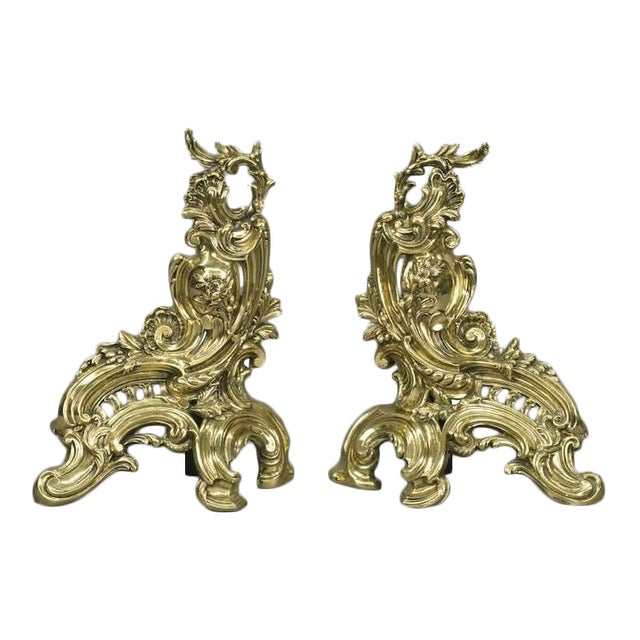 Three pieces gilt bronze chenets or andirons with large fender from France decorated in a floral and shell motif, circa...