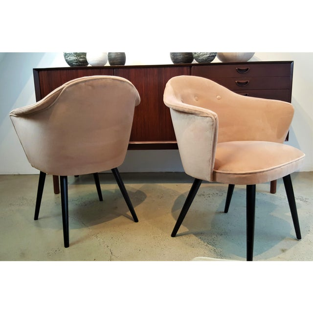 Striking, sculptural pair of Italian midcentury occasional chairs fully restored in a luxe, soft blush velvet. These...