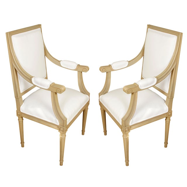 A Set of Ten Louis XVI Style Dining Chairs with a painted finish, including two armchairs and eight side chairs. The clean...