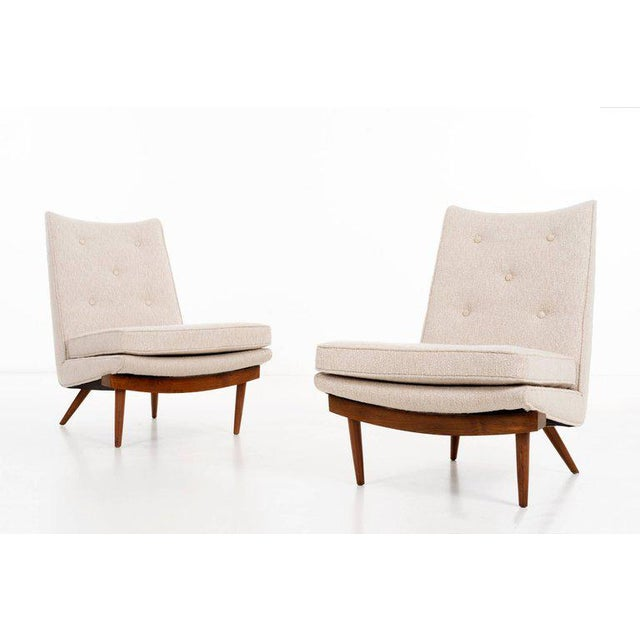 """GEORGE NAKASHIMA (1905 - 1990) """"Origins Collection"""" Chairs Pair of fine button-tufted upholstered lounge chairs raised on..."""