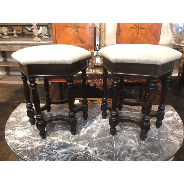 Nice pair of antique English stools covered in linen. Rich patina and nice form make these an excellent addition to any...