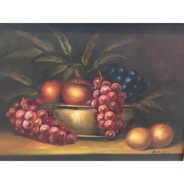 Assorted fruit is depicted in this traditional still life oil on canvas painting. The piece is signed M.Morgan, could be...