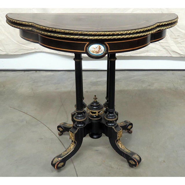"Louis Philippe paint decorated leather top demilune card table with bronze accents. 36"" diameter when opened."