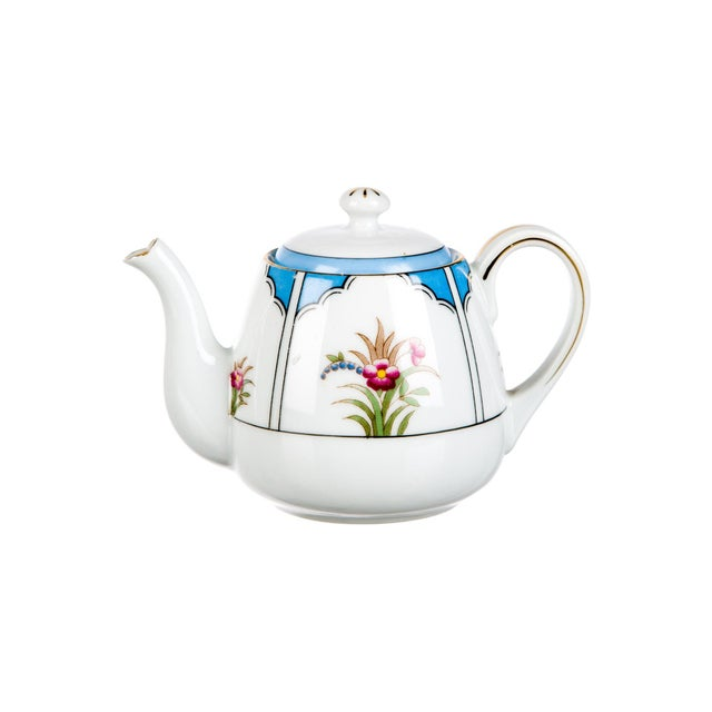 Stunning tea set 15-Piece Noritake Child's Tea Service Description 15-piece white, blue and multicolor hand-painted china...