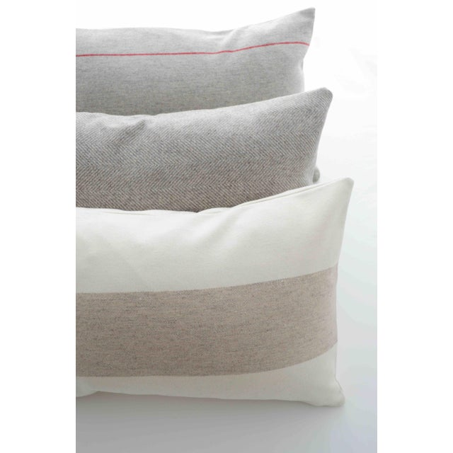 This pillow is made of a sustainable fabric produced in Italy using wool fibers obtained recycling old clothing, knits and...